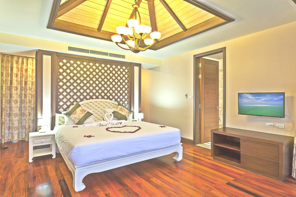 Comforting bedroom interior of a fully air conditioned private pool villa in Southern Thailand