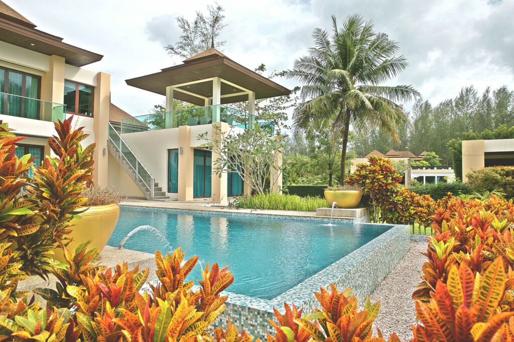 Upper floor terrace and swimming pool at the 2-storied premium villa in Southern Thailand