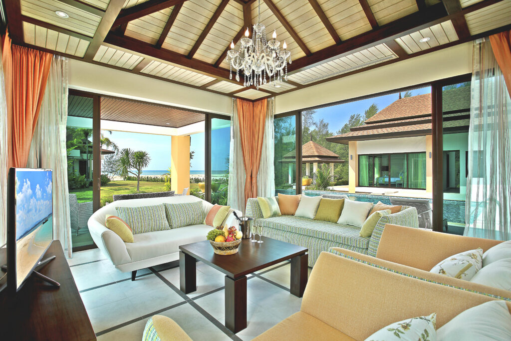Living room of private pool villa with sofa and TV with Netflix and Amazon Prime. Fully air conditioned